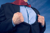 Businessman opens suit showing his shirt — Stock Photo