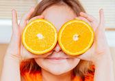 Child holds orange — Stock Photo