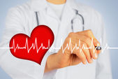 Doctor writes with pen shape of heartbeat — Stock Photo