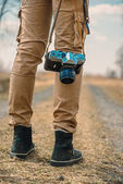 Traveler with vintage photo camera — Stock Photo