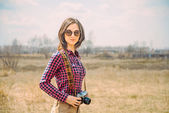 Hipster girl with vintage photo camera — Stock Photo
