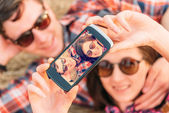 Happy couple takes photographs self portrait — Stock Photo