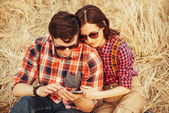 Young couple watching to the mobile phone — Stock Photo