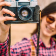 Girl with retro photo camera — Stock Photo