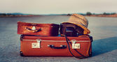 Suitcases on road — Stock Photo