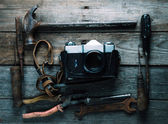 Working tools and photo camera — Stock Photo