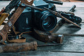 Working tools and vintage photo camera — Stock Photo