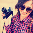 Woman holds camera — Stock Photo