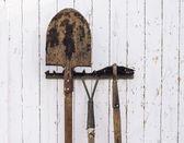 Gardening tools near a wall — Stock Photo