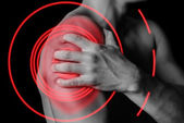 Pain in shoulder — Stock Photo
