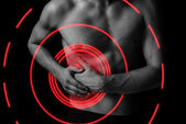 Pain on the right side of abdomen — Stock Photo
