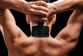 Sportsman holds dumbbell — Foto de Stock