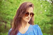 Girl in sunglasses outdoor  — Stockfoto