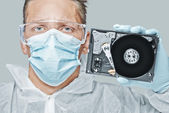 Technician holds the hard disk — Stock Photo