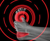 Pain in the foot, pain area of red color — Stock Photo
