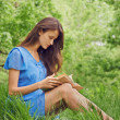 Woman reads book in summer park — Stock Photo #48527931