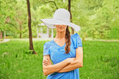 Young woman in fashionable hat — Stock Photo