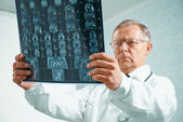 Older doctor is analyzing MRI image — Stock Photo
