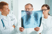 Doctors examine x-ray image — Stock Photo