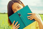 Happy woman with book  — Stock Photo