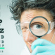 Funny doctor ophthalmologist — Stock Photo #49628863