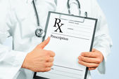 Man doctor with prescription paper — Stock Photo