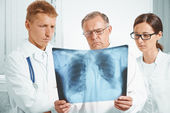 Doctors examine x-ray image of lungs — Stock Photo
