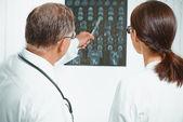 Doctors examine MRI image — Stock Photo
