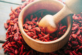 Dried goji berries in mortar — Stock Photo
