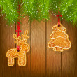 Cookies on a Christmas tree on a background of a wooden texture. — Stock Vector