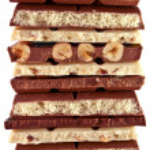 Pieces of white and dark chocolate — Stock Photo #38416087