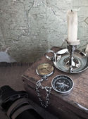 Compass and candle — Stock Photo