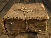 Old book wrapped in canvas — Стоковое фото