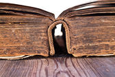 An old book on a wooden table — Stock Photo