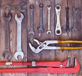 Adjustable wrench set on a wooden background — Stock Photo