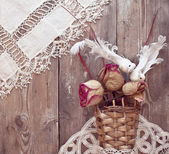 Basket with dried roses and white birds — Stok fotoğraf
