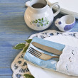 Vintage table setting with leaves decorations, napkins on a blue — Stock Photo