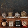 Stock Photo: Old clock on a grungy background. Collection of vintage watches
