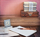 Vintage table with stationery and hours — Stock Photo
