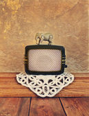 Old radio with a toy elephant — Stock Photo