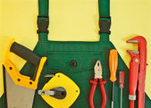 Background with coveralls and a set of tools — Stock Photo
