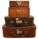 Old suitcases and boxes stacked. — Stock Photo