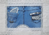 Cute frame with lace and jeans — Stock Photo