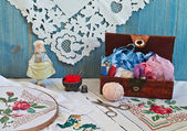 Box for needlework and embroidery hoop — Stock Photo