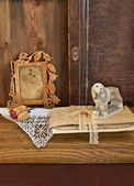 Vintage frame with a portrait of a woman and old letters — Stock Photo