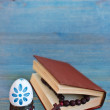 Easter egg in a stand, bible and wooden cross — Stock Photo #44115535