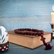 Easter egg in a stand, the Bible and candle — Stock Photo #44115543