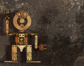 Robot of the metal parts on a dark grungy background — Stock Photo
