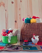 Sewing accessories in the basket. Yarn, ribbon box, glasses and  — Stock Photo