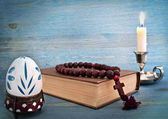 Easter egg in a stand, the Bible and candle — Stock Photo